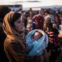 Turkey - Syrian Kurds Flee Kobane As Islamic State Forces Approach